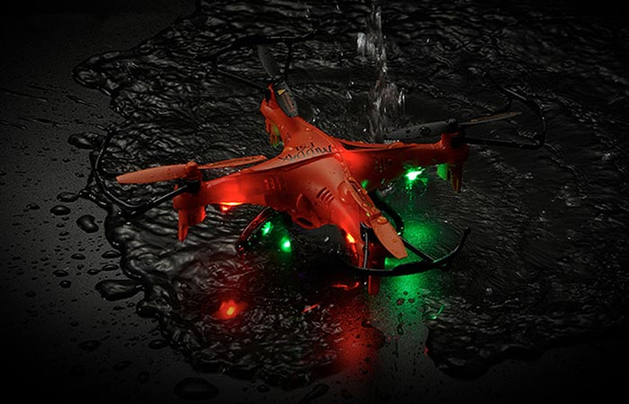 GPTOYS F51C RC Quadcopter in water with it's LED lights on