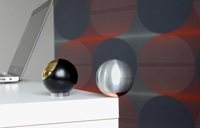 One Gr2 sphere on its stand an another on its lid