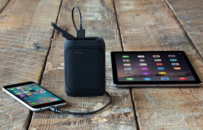 Griffin Survivor charging an iPhone with an iPad next to it