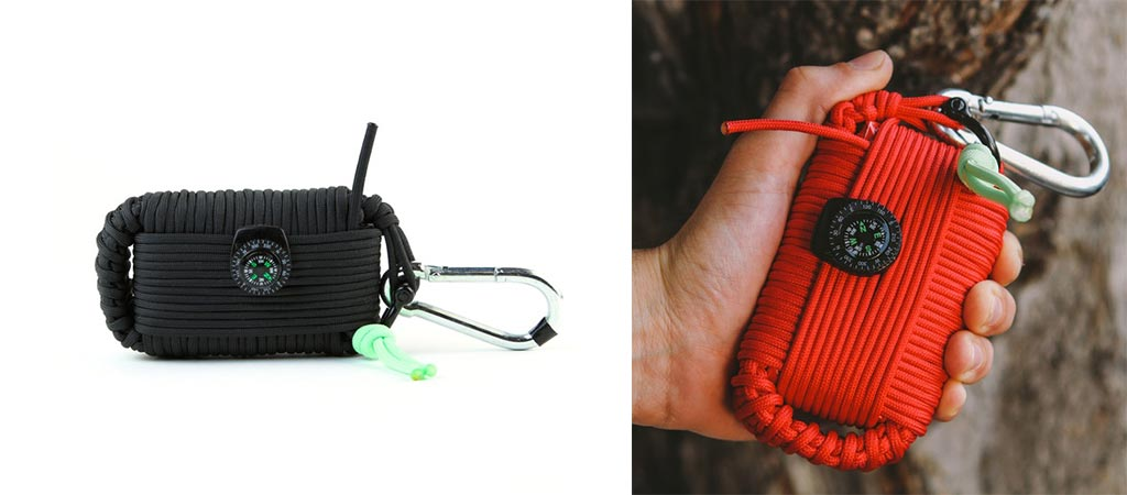Survival Grenade with black Paracord and another being held by someone with red Paracord