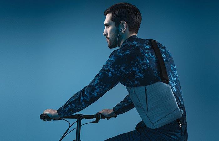 A Guy On A Bike Wearing Baggizmo