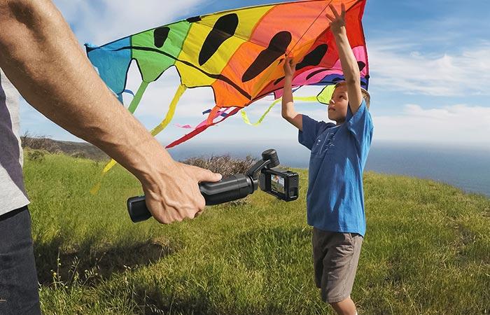 Man using the GoPro Karma's detachable stabilizer