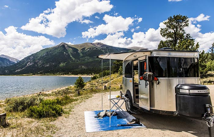 Airstream Basecamp Parked Next To A Lake