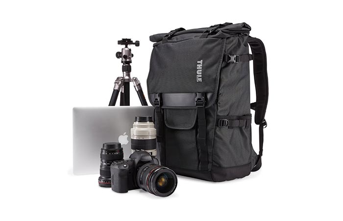 Thule Covert DSLR Rolltop Backpack With Camera Eqipment Next To It