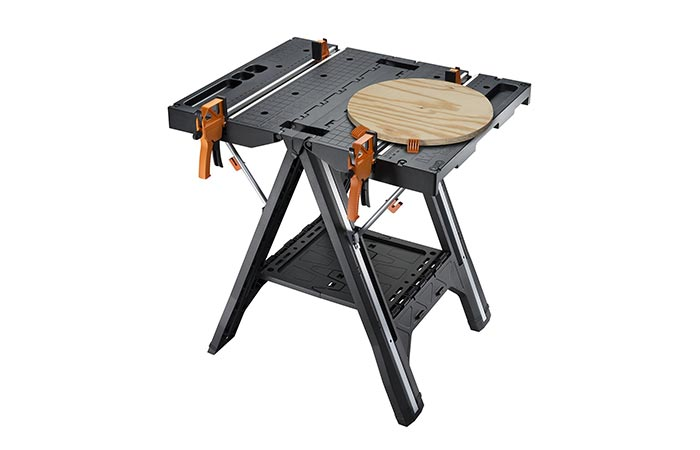 WORX Pegasus Folding Work Table with a circular piece of wood on it