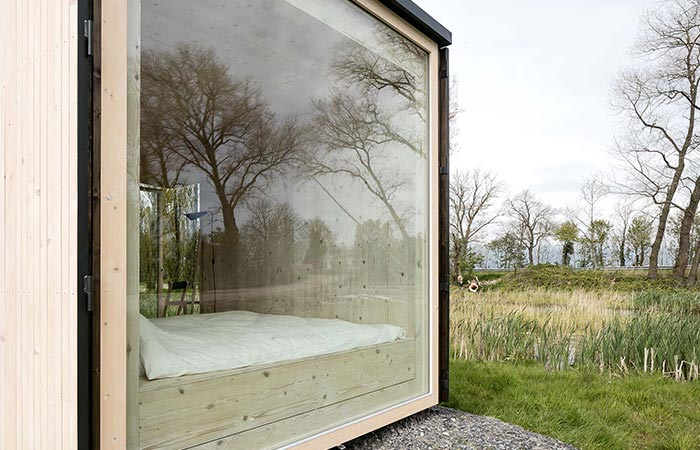 A glass window on a wooden cabin