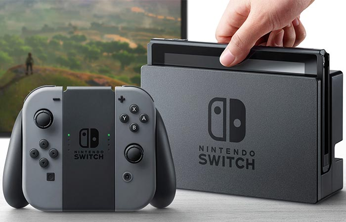 Nintendo Switch with its gamepad and docking station