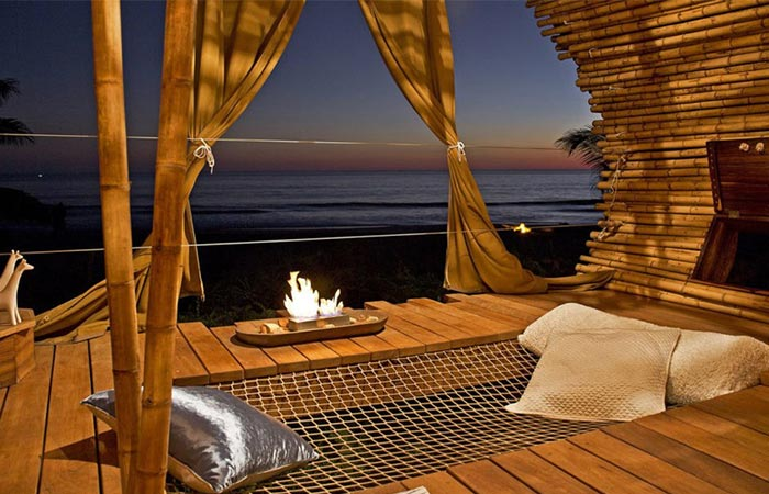 the interior of the Playa Viva treehouse room and the view of the ocean