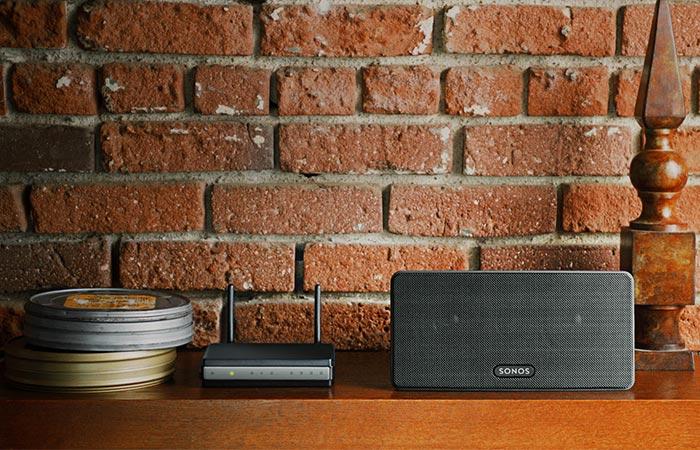 Black wireless speaker on a shelf