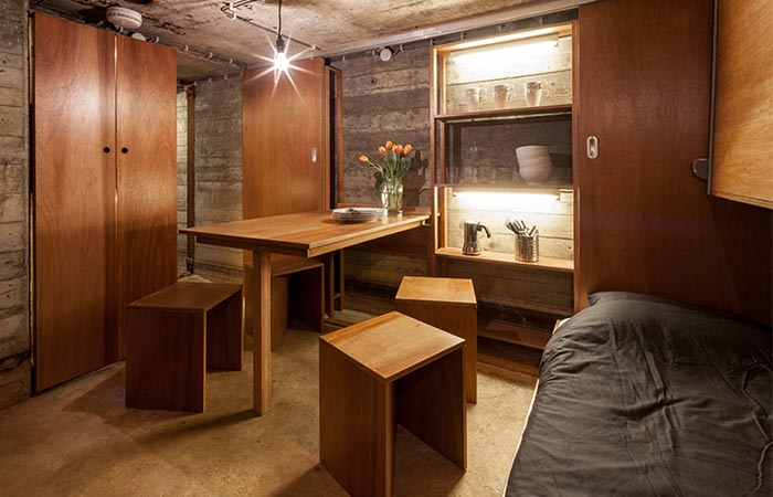 a main room in the bunker with a dining table