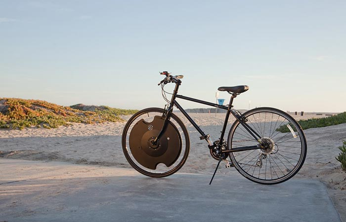 Bicycle with Electron Wheel on the beach