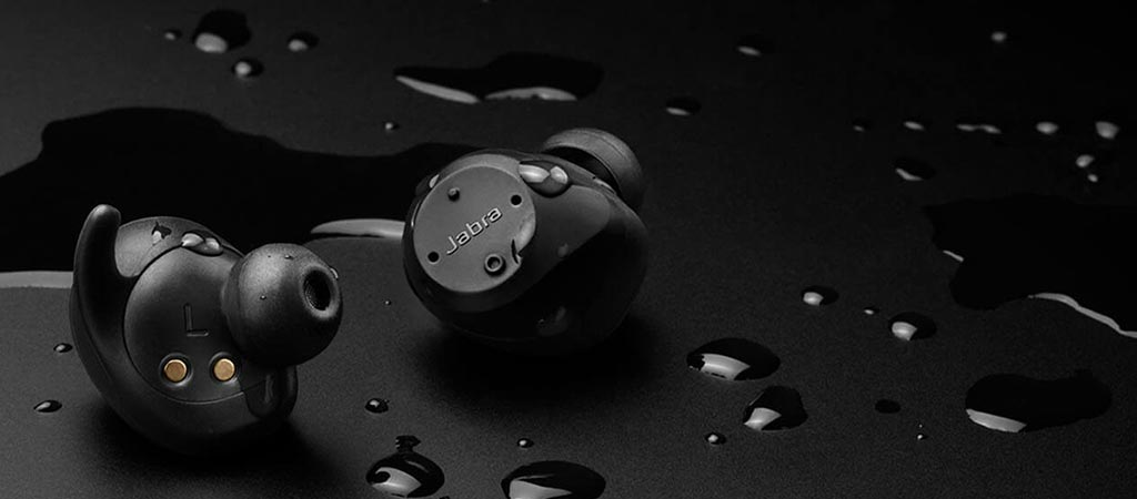 Jabra Elite Sport with a black background and water droplets