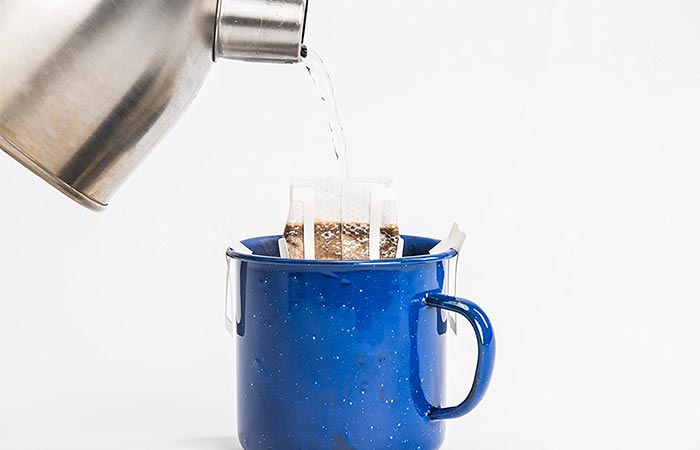 Water being poured into a Libra Pourtable coffee bag.