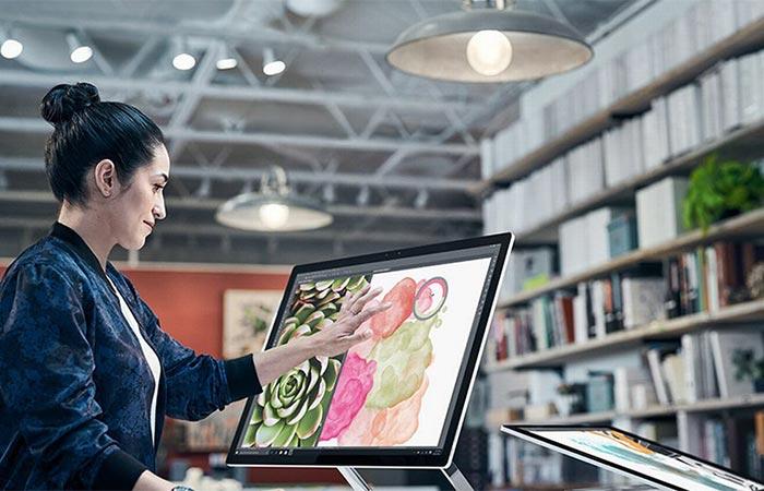 Woman using the Microsoft Surface Studio