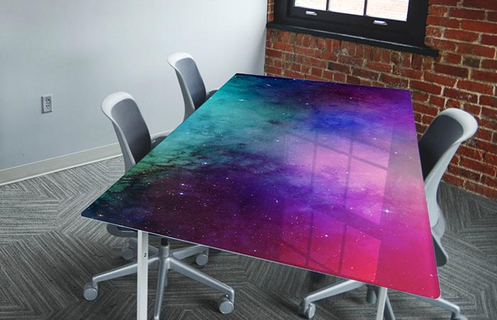 An office desk with a nebula wrap