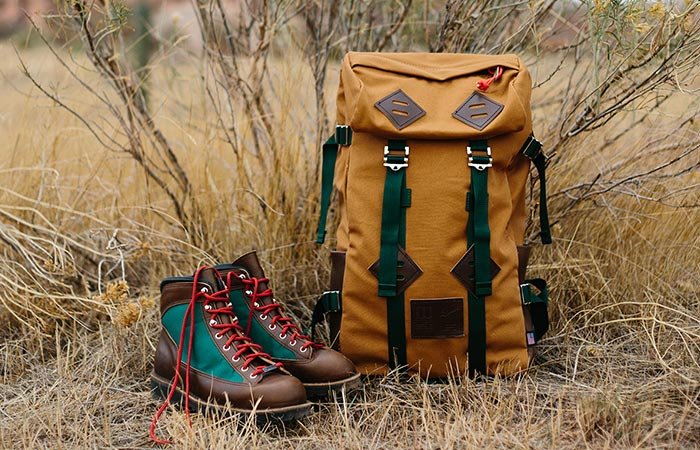 leather boots next to a backpack
