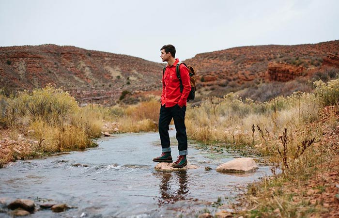 a guy standing on a stream