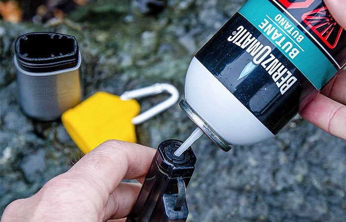 UCO Torch Lighter being refilled