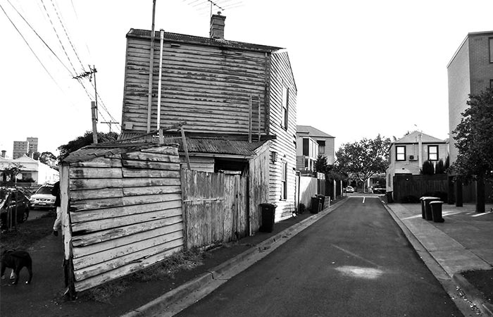 black and white picture of an old corner house