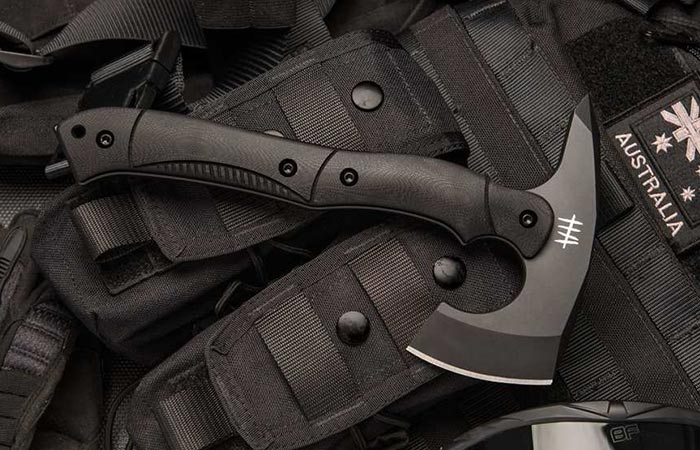 Hardcore Hardware Compact Tactical Tomahawk in black on a vest