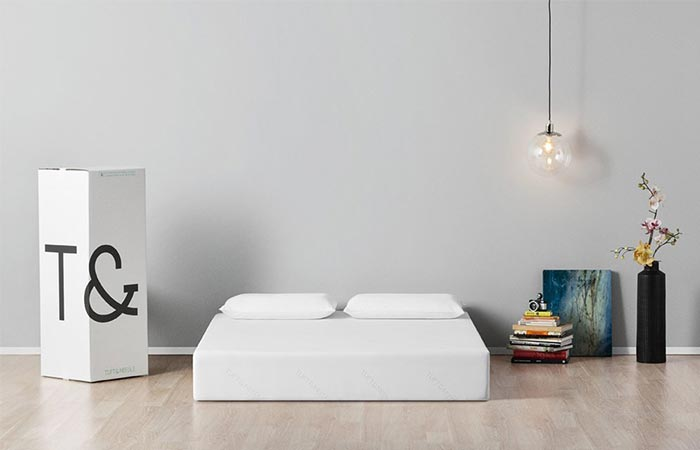 a white mattress on the floor