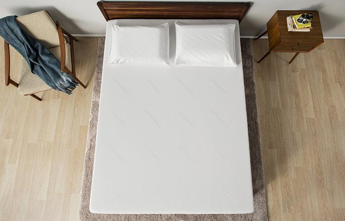 bed with a white mattress from the above