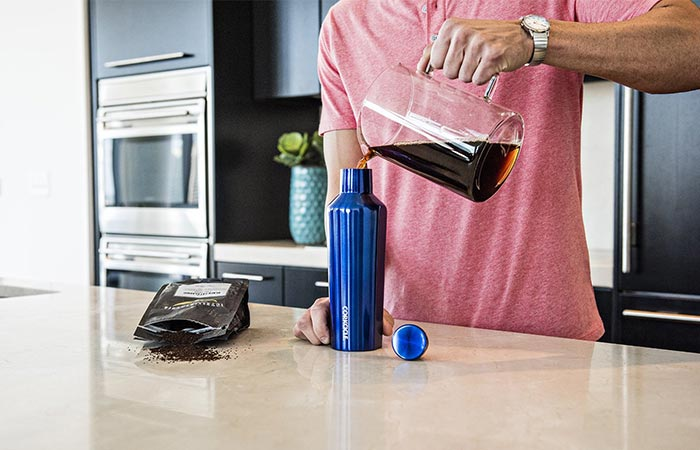 pouring coffee inside Corkcicle Canteen