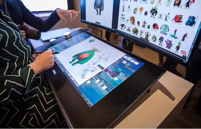 Dell Canvas 27 being used by a woman
