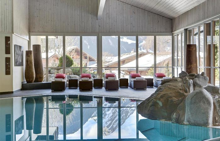 swimming pool in HUUS Hotel Gstaad