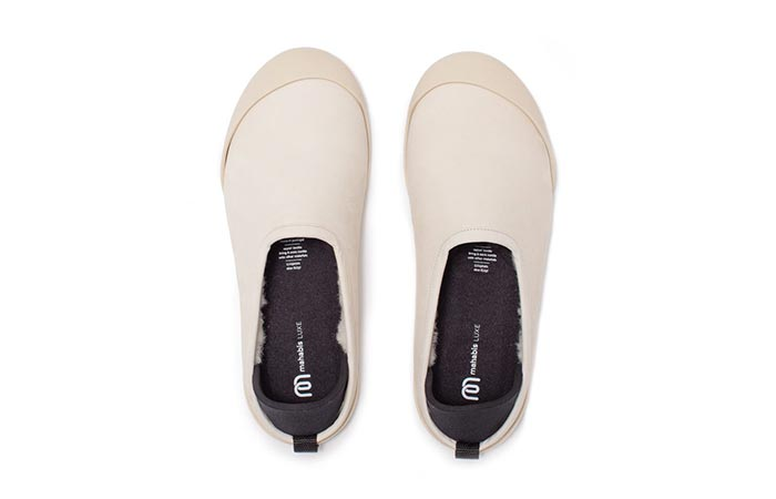 a pair of white mahabis luxe slippers
