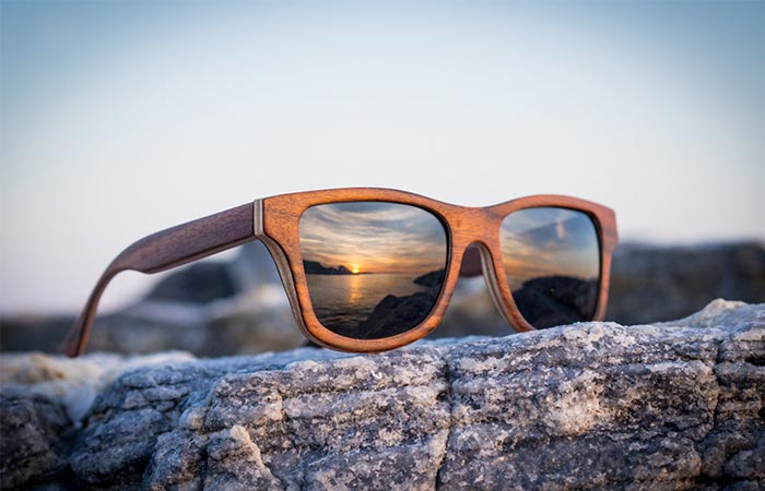 wooden glasses on a stone