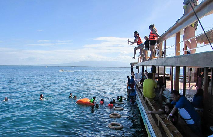 People jumping off the TawHai Floating Bar