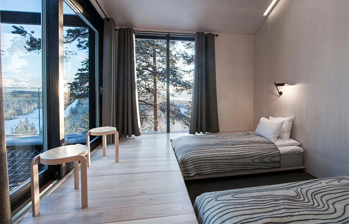 a bedroom inside The 7th Room Treehotel