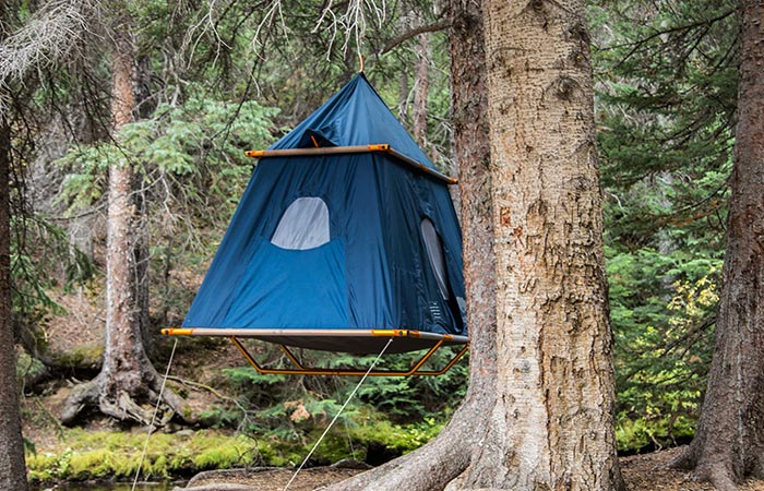 TreePod Suspended Camper Tent hanging in a tent