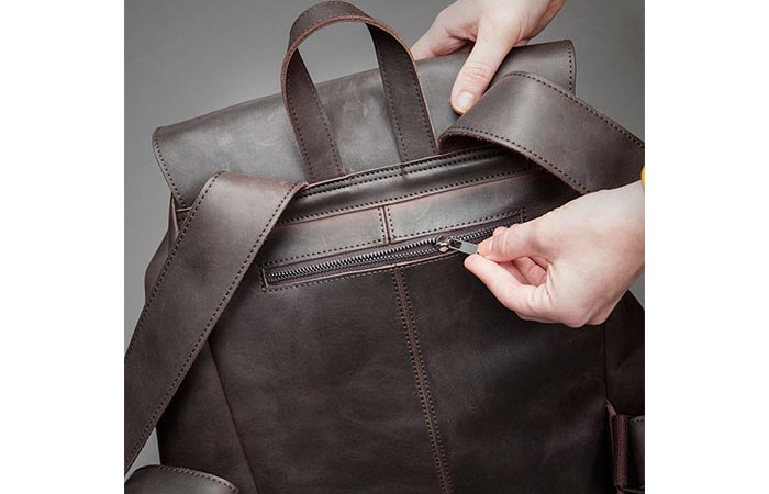 back zipped pocket on a leather backpack