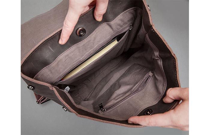 inside the main compartment of a leather backpack
