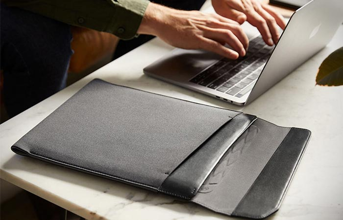 grey Bellroy Laptop Sleeve on a table