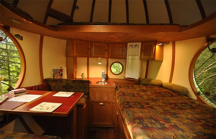 a bedroom and table inside Free Spirit Sphere