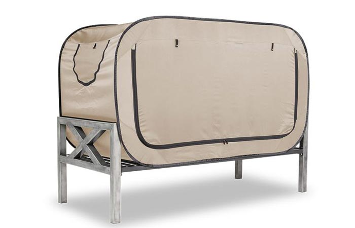 The Bed Tent in tan with the doors zipped closed