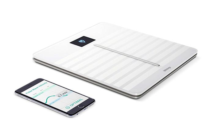 Withings scale next to a phone