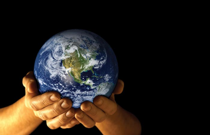 Person holding the world in their hands