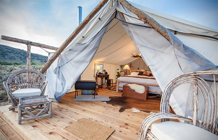 a wooden porch and inside of a tent