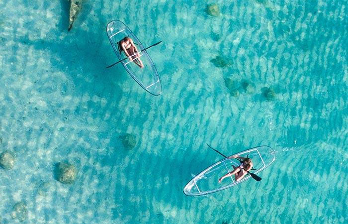 two crystal kayaks in water