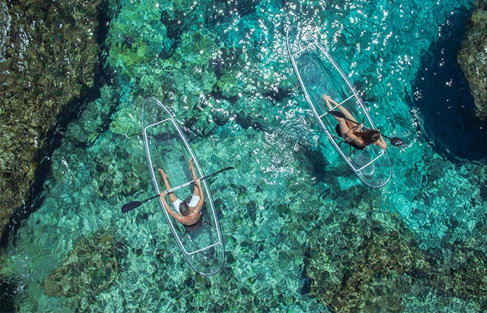 sitting on a crystal kayak