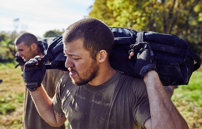 Men carrying the GoRuck 60lb Training Sandbag on their shoulders