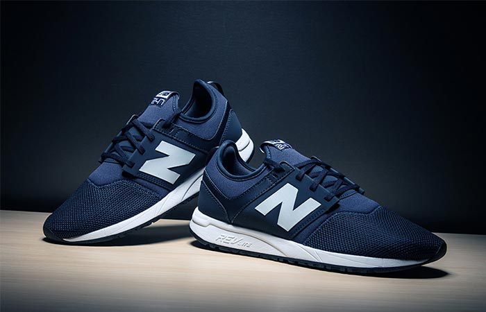 a pair of New Balance 247 Classic in navy
