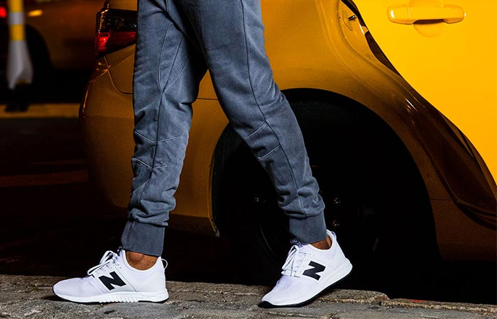 a guy wearing white New Balance 247 Classic