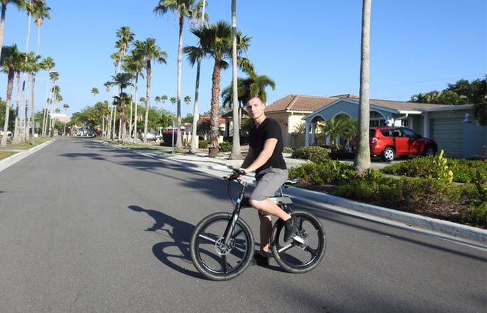 a guy riding a black Chainless bicycle