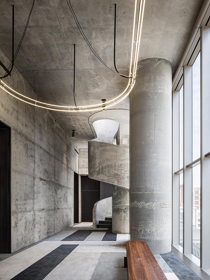 a concrete hall inside 56 Leonard tower