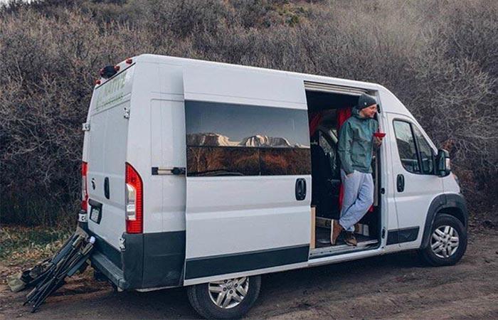 a guy standing in a van